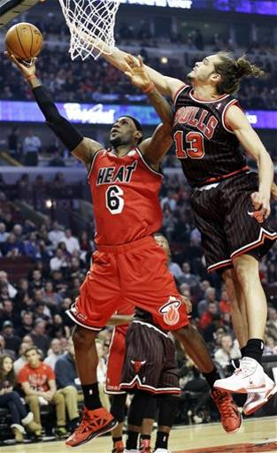 LeBron glides past Joakim Noah during last night's win (AP Photo/Nam Y. Huh)