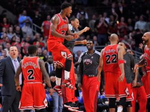 Chicago's Jimmy Butler celebrates during a timeout. His 17 points helped Chicago to a 101-97 victory (Rob Grabowski/USATodaySports)