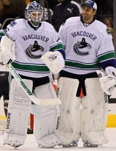 Luongo (right) stands with Schneider (Photo by Victor Decolongon/Getty Images)